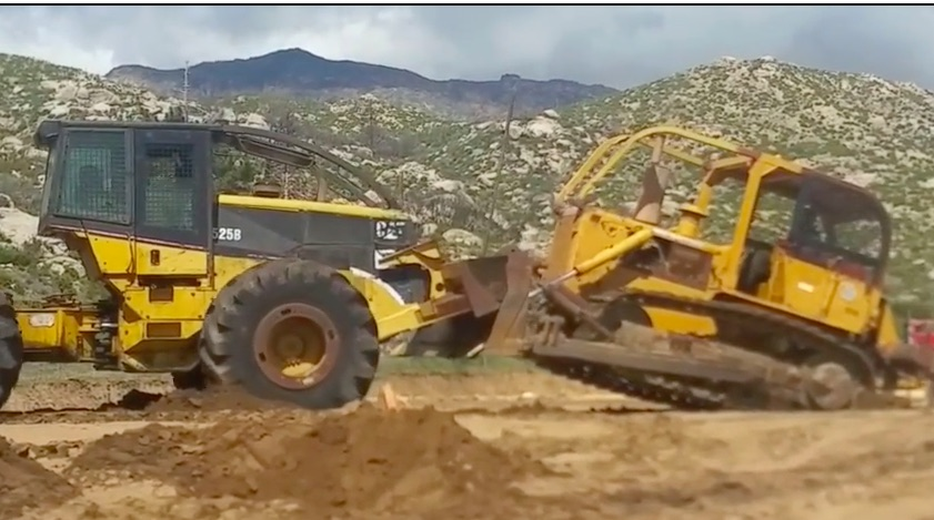 Battle! Watch A Log Skidder and A Bulldozer Have A Push-Off In The Wild!