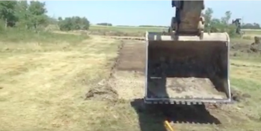 Mad Skills Yo: Watch This Excavator Operator Literally Plant His Stake With The Bucket