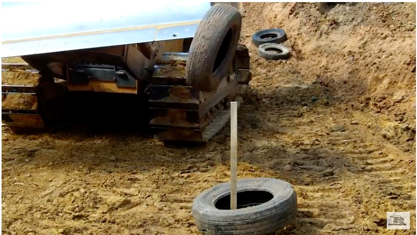 Got Skills? Watch This Bulldozer Operator Stack Tires Around A Stake Using The Blade Of His Machine