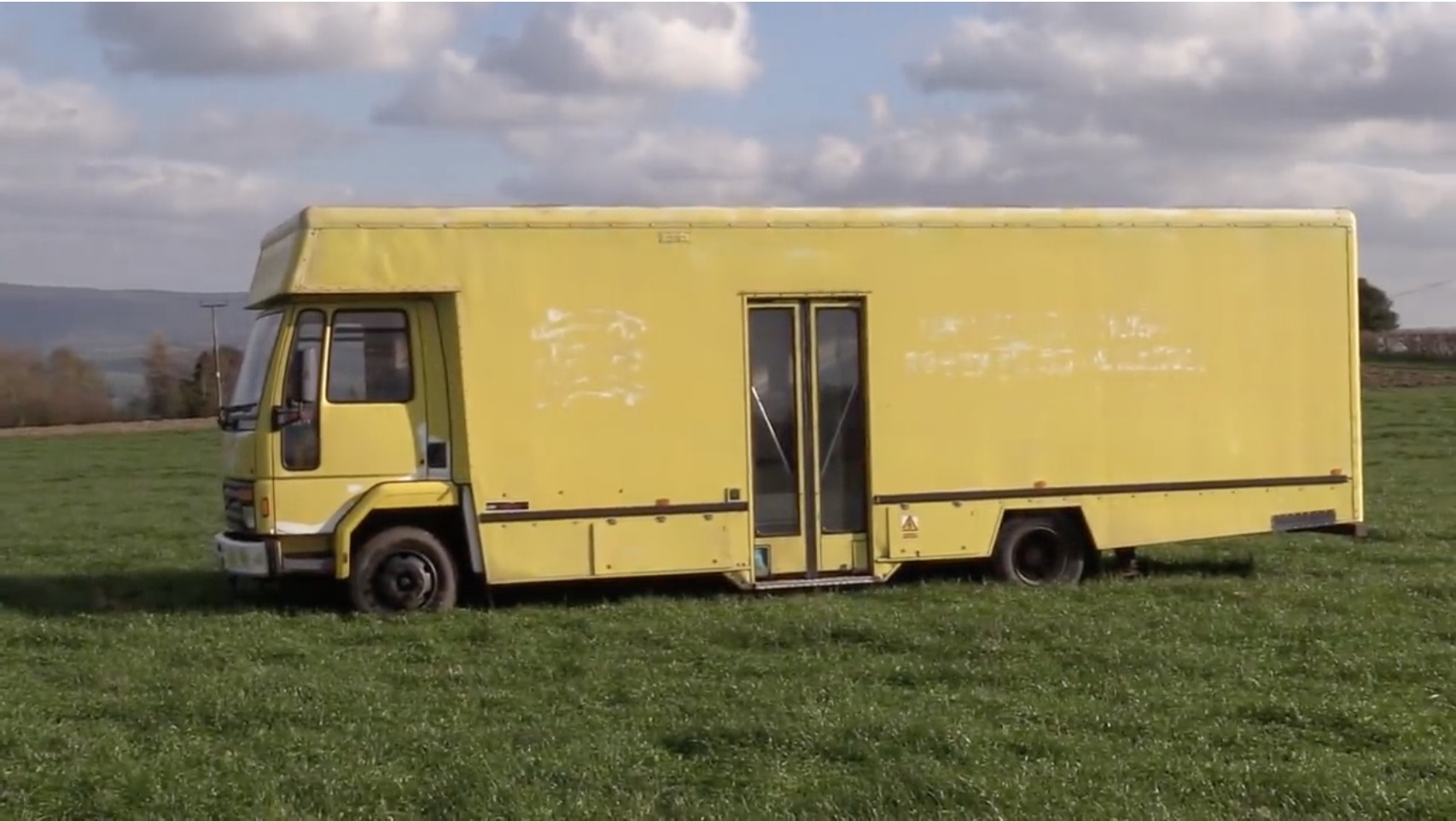 The Escargot: Taking A Big, Yellow Truck And Making It A Dream Car Hauler-Slash-RV