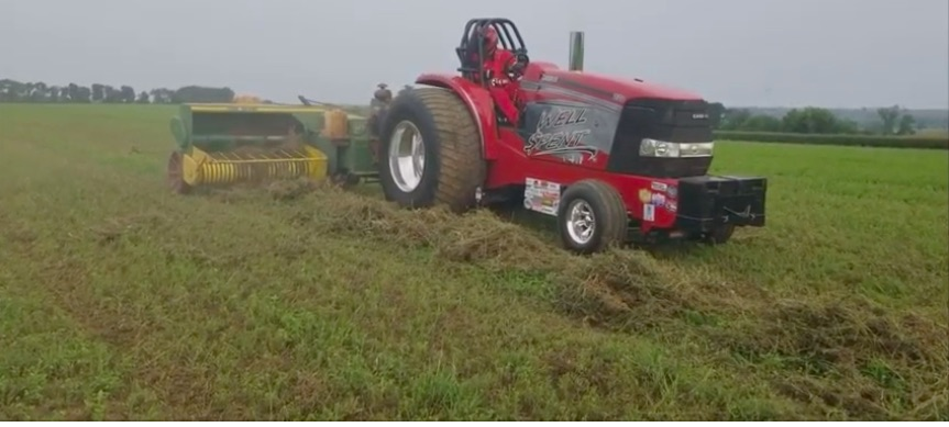 Impractical? Fooey! Watch This Pulling Tractor Take Care Of Multiple Jobs On The Farm!