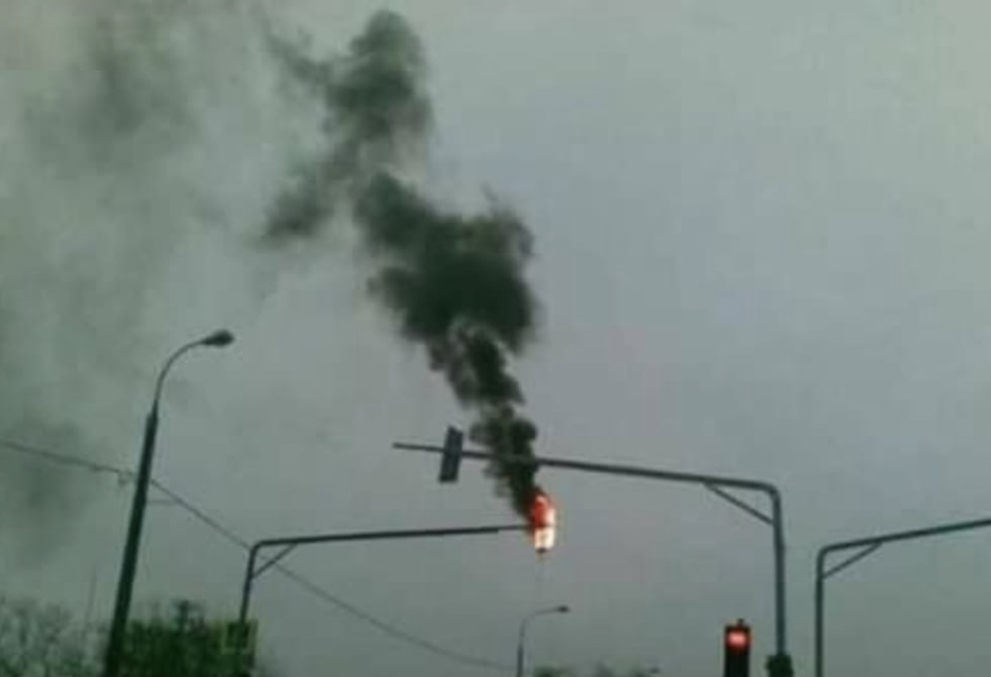 Caption This: There Wasn't One Word About A Burning Traffic Light In That Stupid Little Handbook…