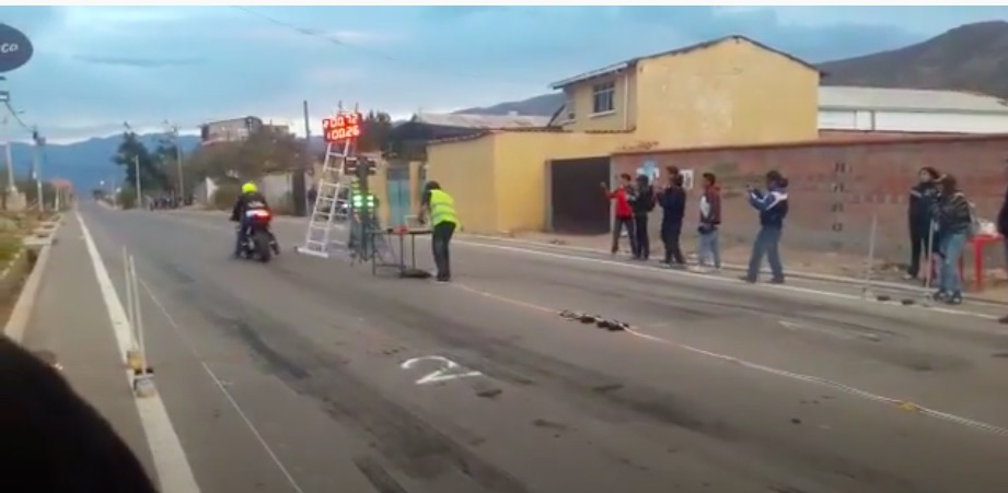 One Bad Launch: Watch This Motorcycle Drag Racer In Bolivia Take Out The Scoreboard, The Tree, and Nearly The Starter! DOH!