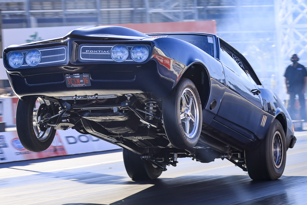We've Got All The Door Car Drag Racing Action Photos You Can Stand! Small Tire, Big Tire, Radials, And No Time From The Street Car Super Nationals