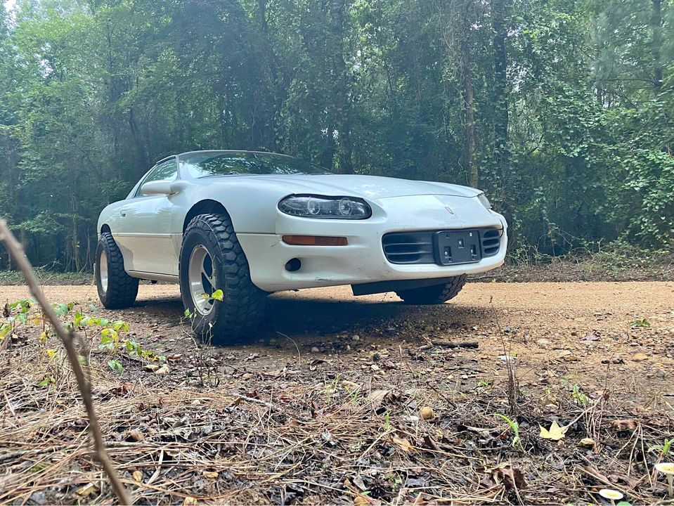This 1999 Camaro Is Fire Road Greatness! Small Lift, Added Fender Clearance, And Mud Tires Make This Thing Too Awesome